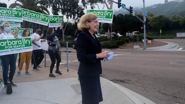 Mayoral candidate Barbara Bry joins with supporters on Election Day for early morning campaigning in La Jolla.