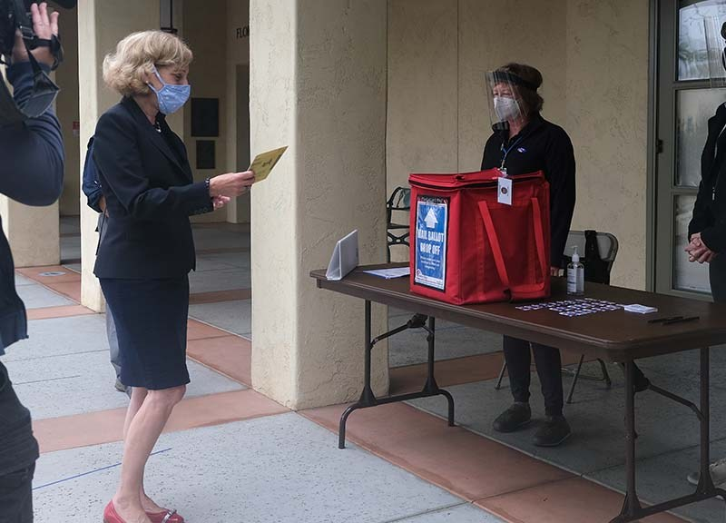 Mayoral candidate Barbara Bry drops off her mail-in ballot at a La Jolla library on Election Day.