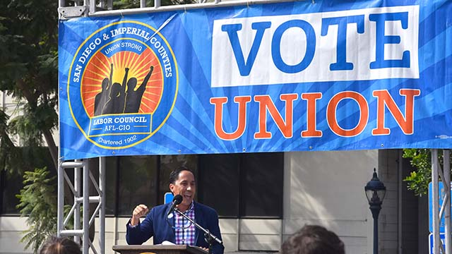Assemblyman Todd Gloria, who is running for mayor, speaks at a car rally downtown on Election Day.