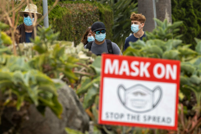 People wearing face masks in Del Mar