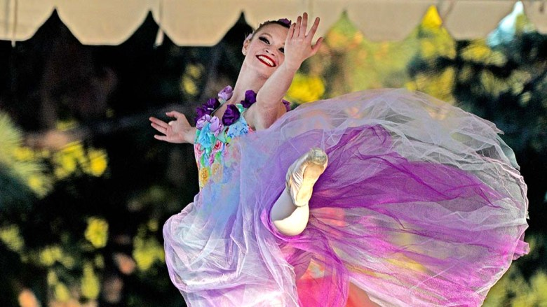 """Phoebe Perry dances in Waltz of the Flowers during a San Diego Ballet's outdoor performance of """"Nutcracker."""""""