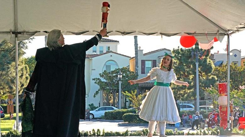 Artistic Director Javier Velaso plays Drosselmeyer and Vanessa Schroeder as Clara perform the Nutcracker ballet in Liberty Station.