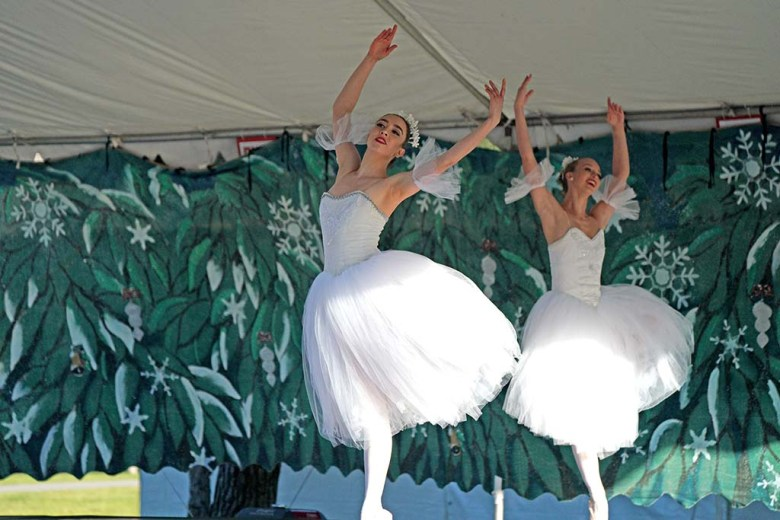 """Isabelle Glavin and Jessica Conniff perform in the snow scene during a drive-in performance of """"Nutcracker"""" at Liberty Station."""
