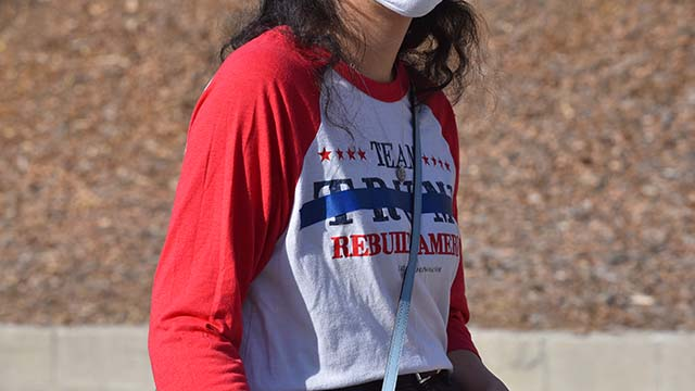 A woman with a Trump t-shirt was asked to put tape across the name before entering the Santee polling place.