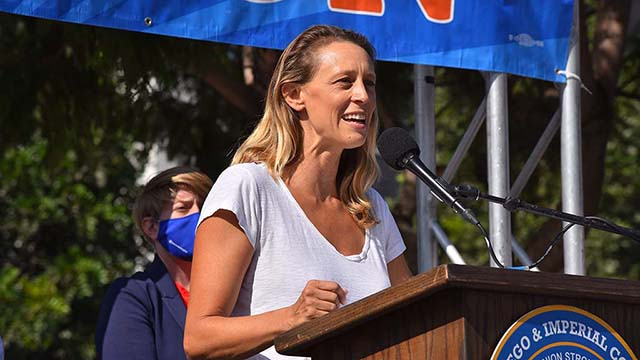 San Diego Board of Supervisor candidate Terra Lawson-Remer speaks to union workers at a car rally downtown on Election Day.