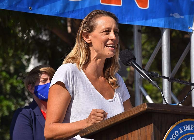 San Diego County Board of Supervisors candidate Terra Lawson-Remer speaks to union workers at a car rally downtown on Election Day.