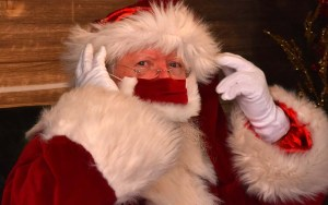 Santa wears a cheery red mask during his stint at Mission Valley Mall.