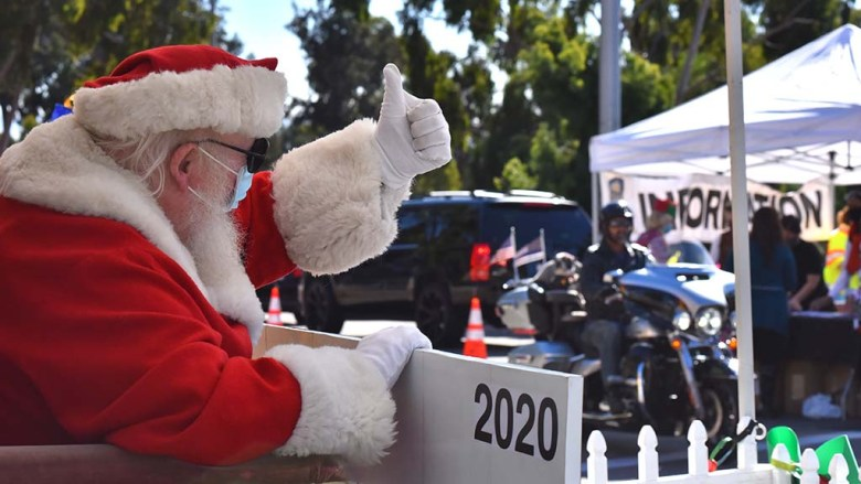 Santa gives a thumbs up to a motorcyclist who is leaving the Taste of December Nights. Santa will be there from 11 a.m.-2 p.m. through Dec. 6.