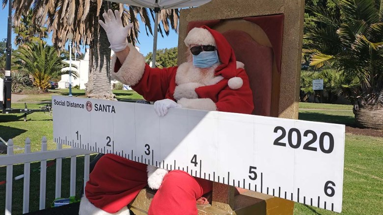 Santa, aka Bill Swank, brought his 6-foot ruler to remind people to social distance during the holiday season.