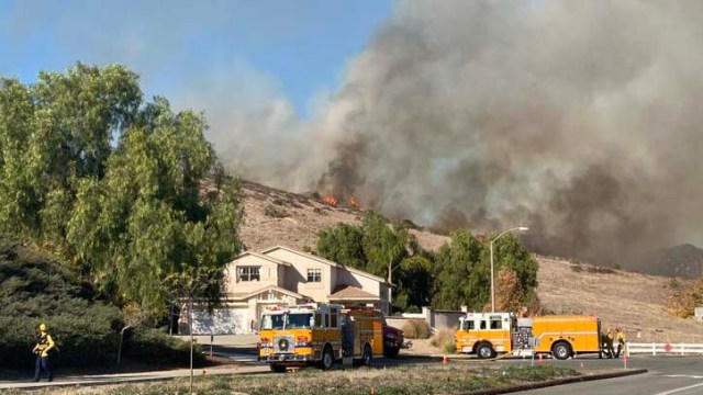 Brush fire on hillside was being fought by Santee Fire Department.