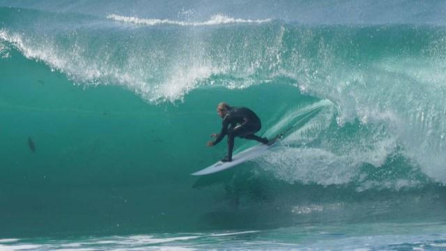 A surfer slides through a barrel into an underwater world north of Windansea on Jan. 9.