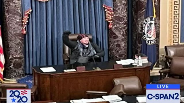 Protester sits in House Speaker's seat