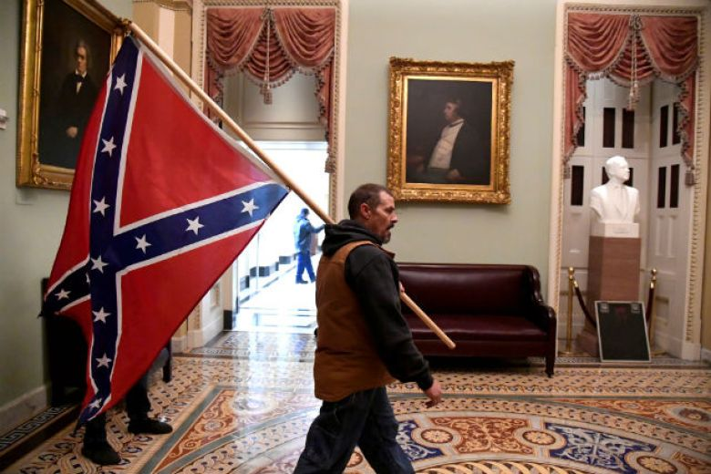 Rioter with Confederate flag