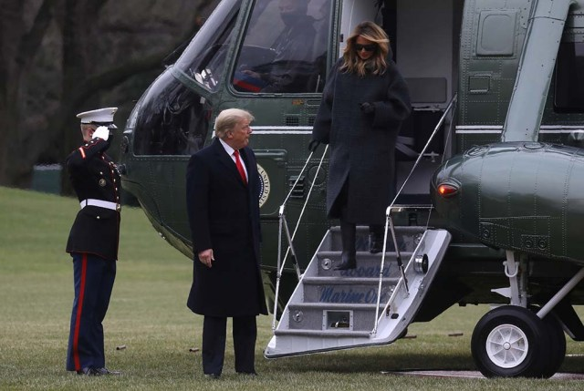 President Trump arrives on Marine One with first lady Melania Trump after returning from Mar-A-Lago on the South Lawn of the White House in Washington on Dec. 31, 2020.