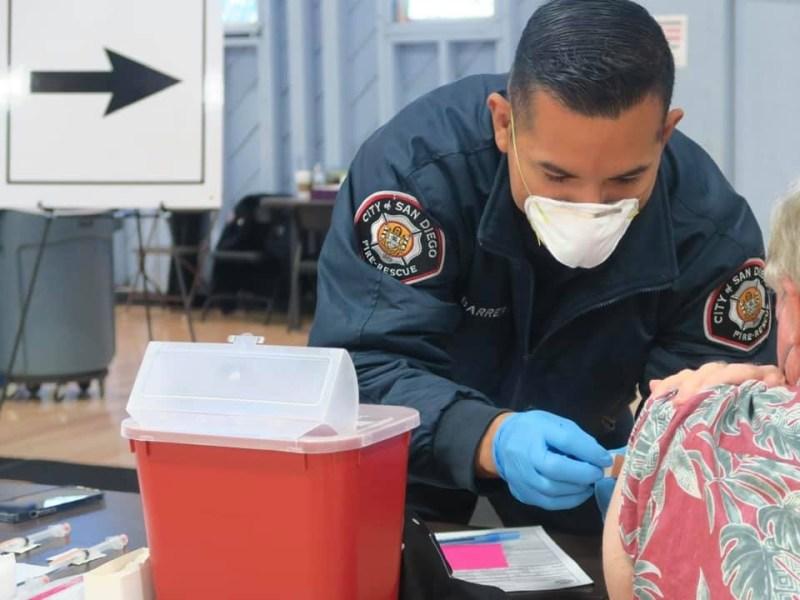Paramedic vaccinates a patient