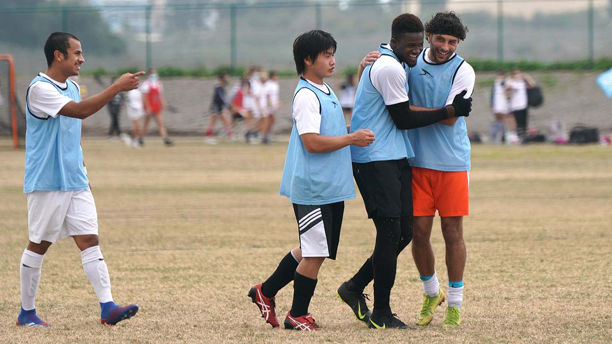 Dawoda Sesay of Phoenix (second from the right) is congratulated by team members after he made a goal during a tryout.