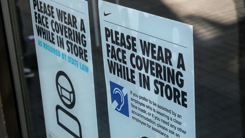 Sign warning shoppers to wear a face covering