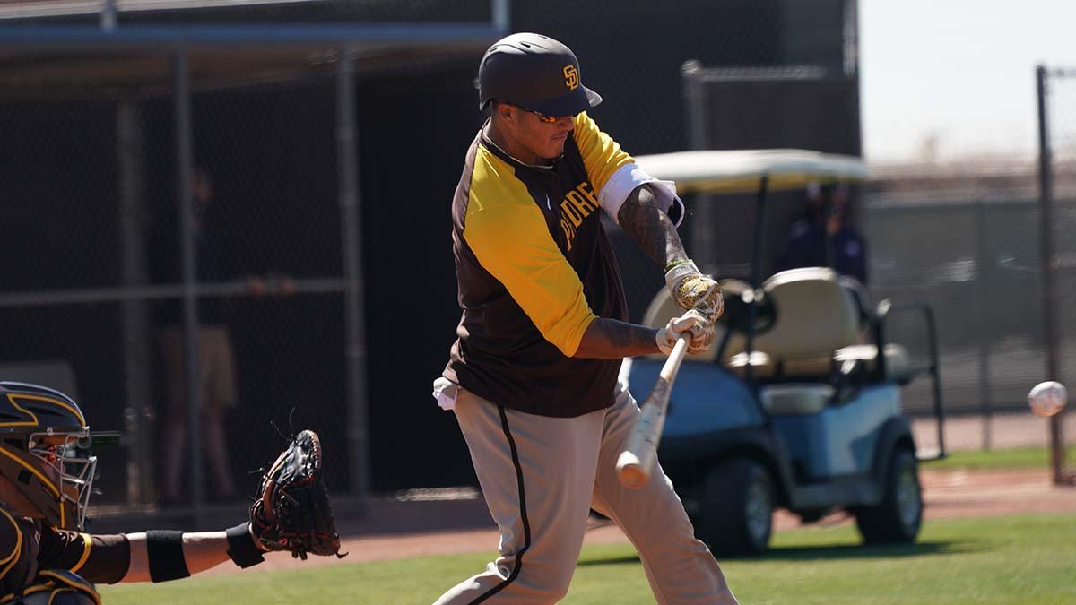 Padre third baseman Manny Machado takes a swing in batting practice.