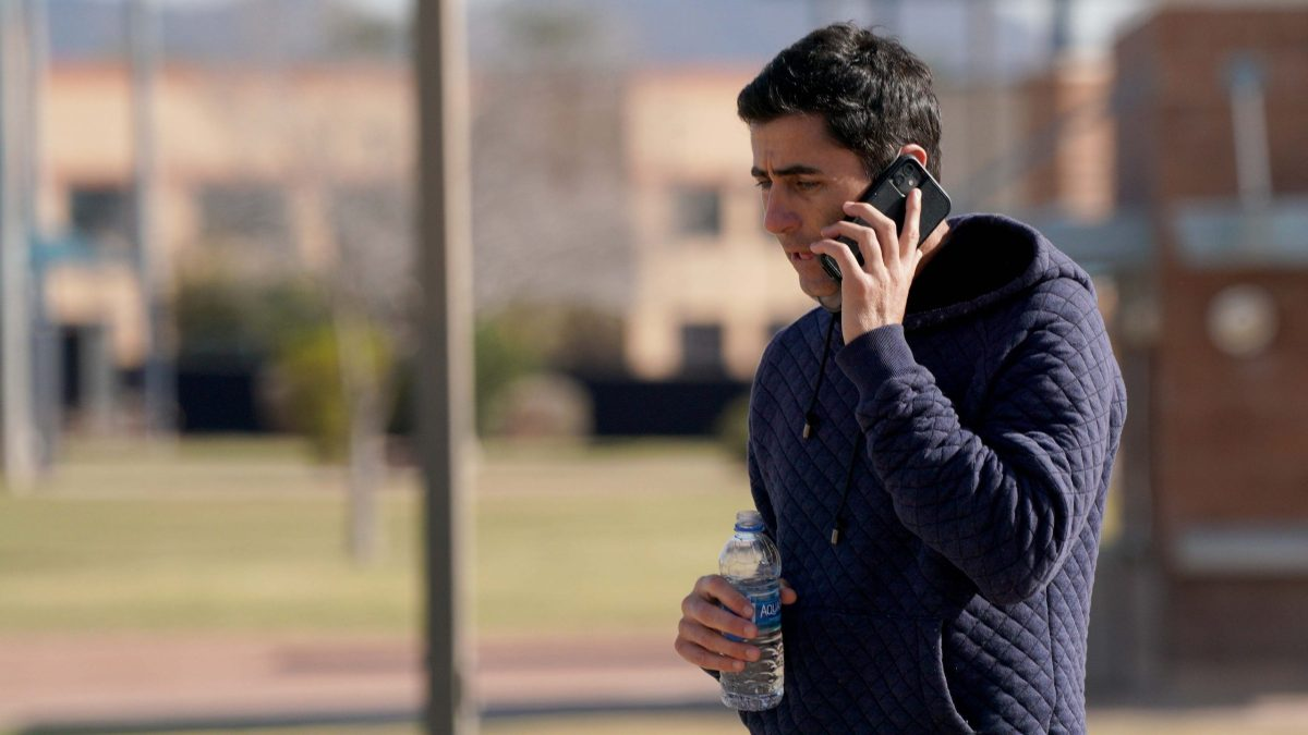 Padre Manager A.J. Preller fields a call during spring training.