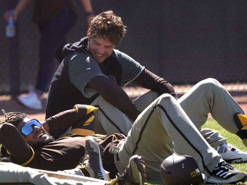 Fernando Tatis Jr. (left) and Wil Myers shares remarks during a few minutes of down time.