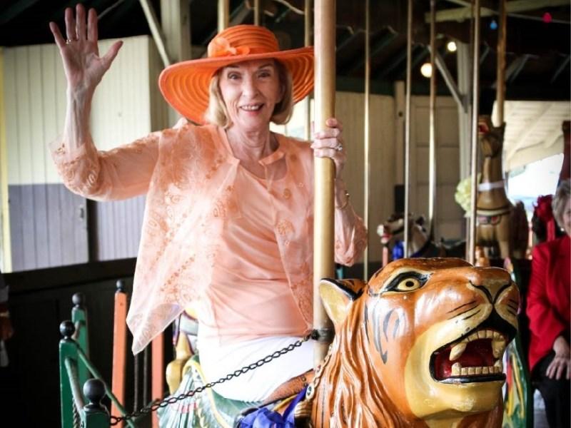 Dorothea Laub rides the carousel