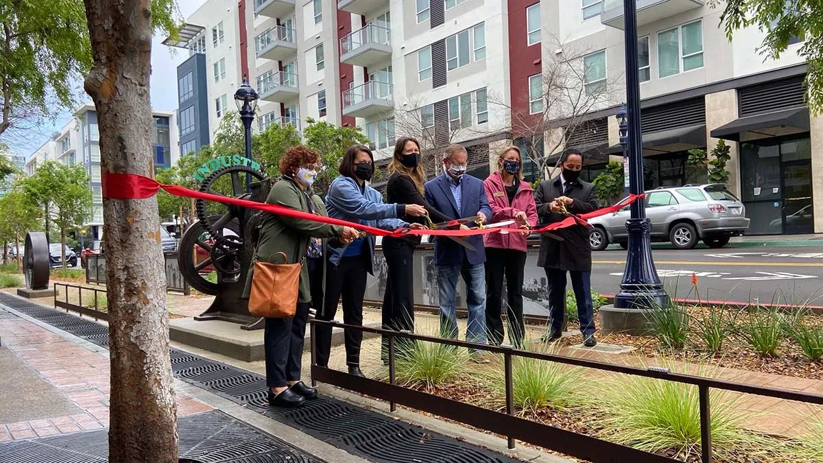 Mayor Todd Gloria (right) and other officials cut ribbon to open section of 14th Street Greenway project.