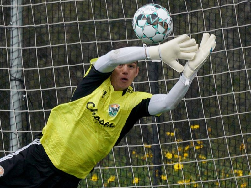 Goal keeper Trey Muse makes a stop during practice at the San Diego Loyal training camp in Chula Vista.
