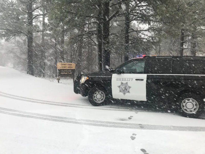 Sheriff's cruiser drives in snow