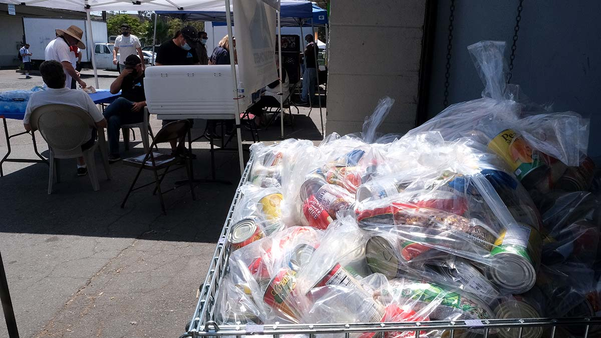 Bags of food are distributed to homeless people during Community Through Hope's Project Refresh in Chula Vista.