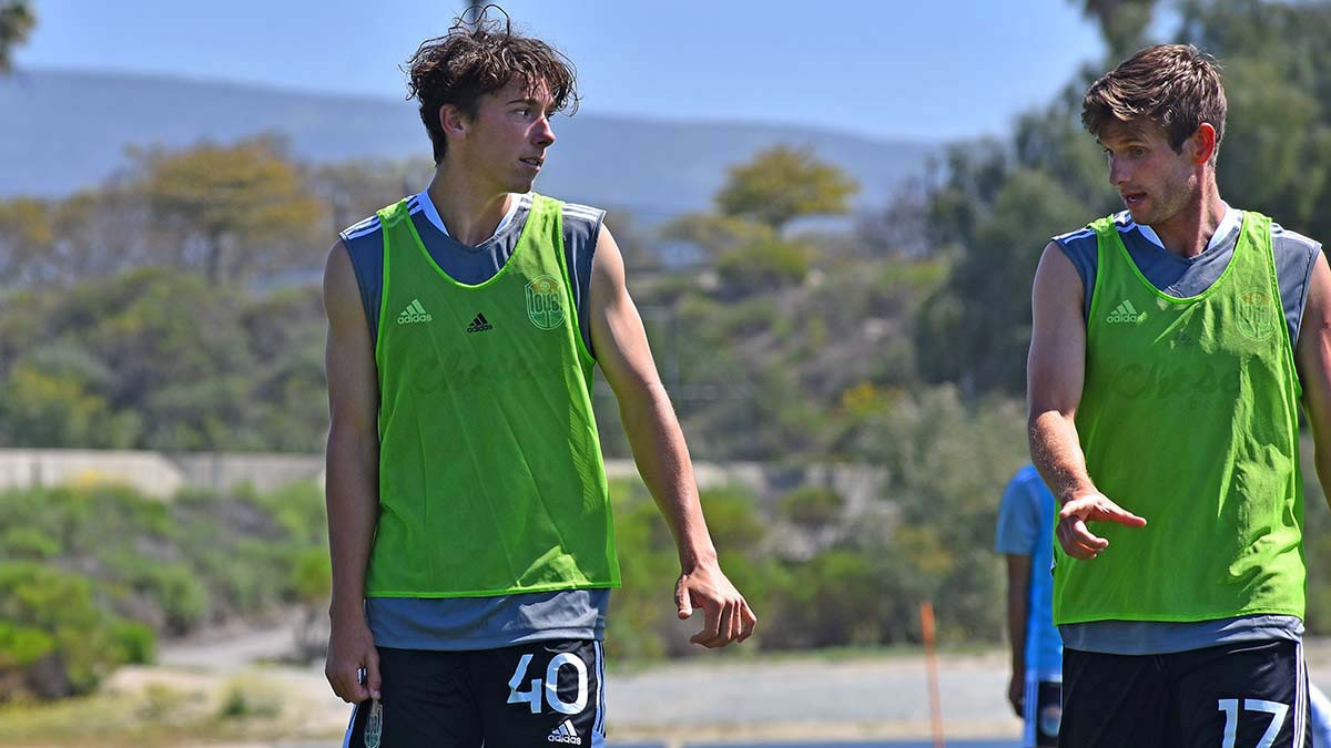 """Calvin Jay """"CJ"""" Fodrey (left) gets advice from San Diego Loyal player Collin Martin during a practice at the Chula Vista Elite Athlete Training Center."""