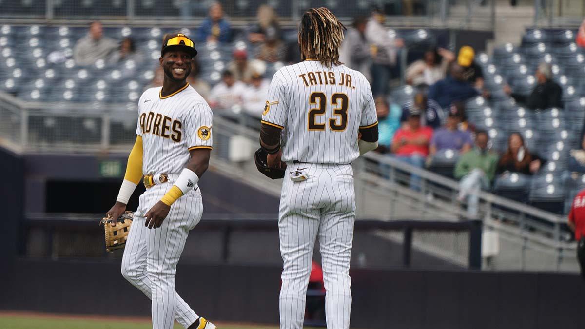 Jurickson Profar (left) and Fernando Tatis share remarks at the start of an inning.