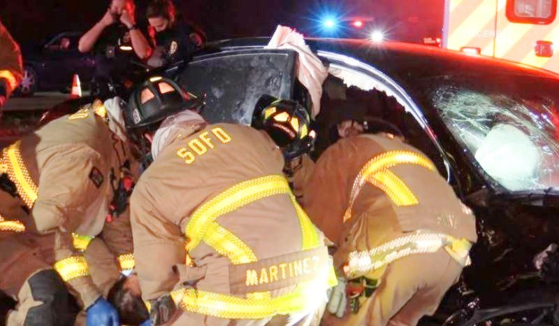 Paramedics work to free a trapped victim