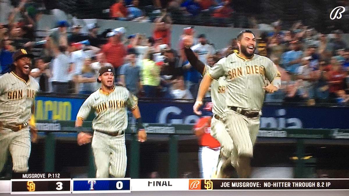 Teammates led by Eric Hosmer rush to mob Padres pitcher Joe Musgrove after throwing first no-hitter in club history.