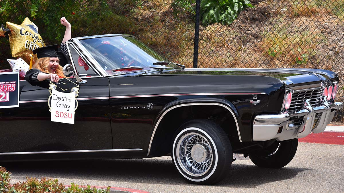 Graduate Destini Gray attends the drive-thru commencement in style in a jacked up Impala lowrider. Photo by Chris Stone