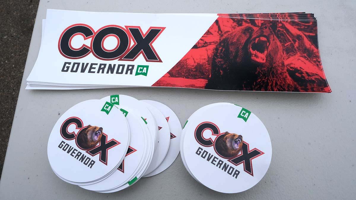 John Cox incorporates a bear image into his campaign literature.