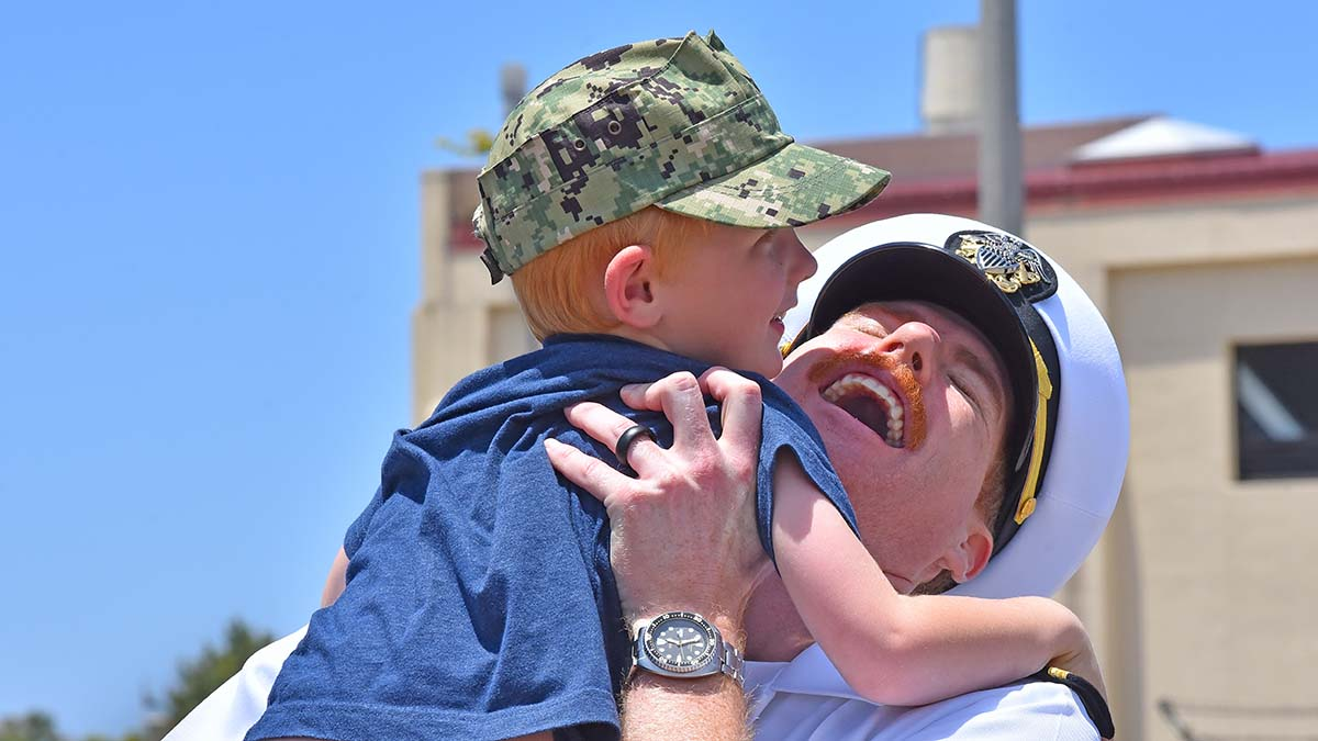 John Millar, is thrilled to see his son, Luke, 4, as he returns home from a seven-month deployment. Photo by Chris Stone