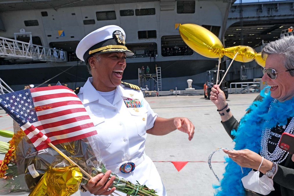 Capt. Madeline Mears is greeted by long-time friends who have known each other since serving together on the USS Nimitz in the 1990s. Photo by Chris Stone
