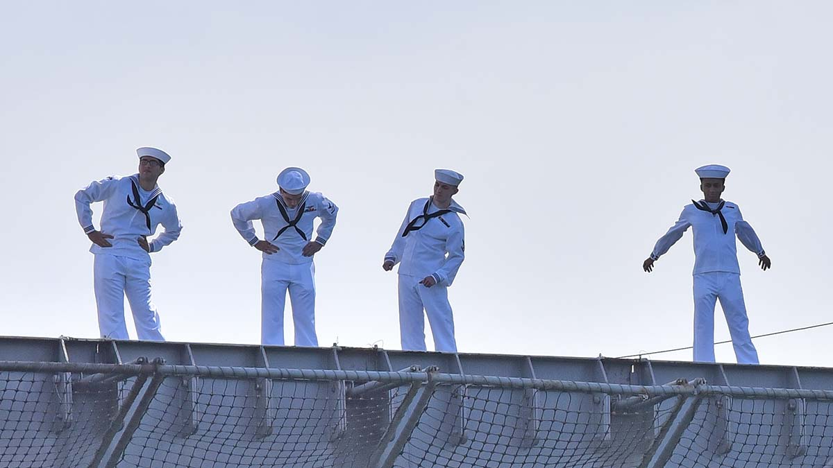 Sailors have a momentary stretch break as they return home to San Diego. Photo by Chris Stone