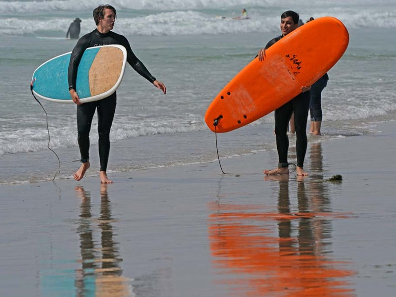 Surfers enjoy the waves at La Jolla Shores. Photo by Chris Stone