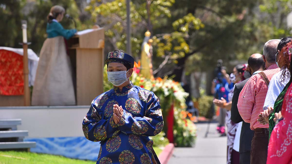 Participants dressed in cultural attire recited prayers of the faithful in their own language. Photo by Chris Stone
