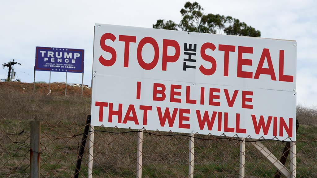 """On Jan. 13, 2021, signs boosted the Trump-Pence ticket as well as """"stop the steal"""" belief. Photo by Chris Stone"""