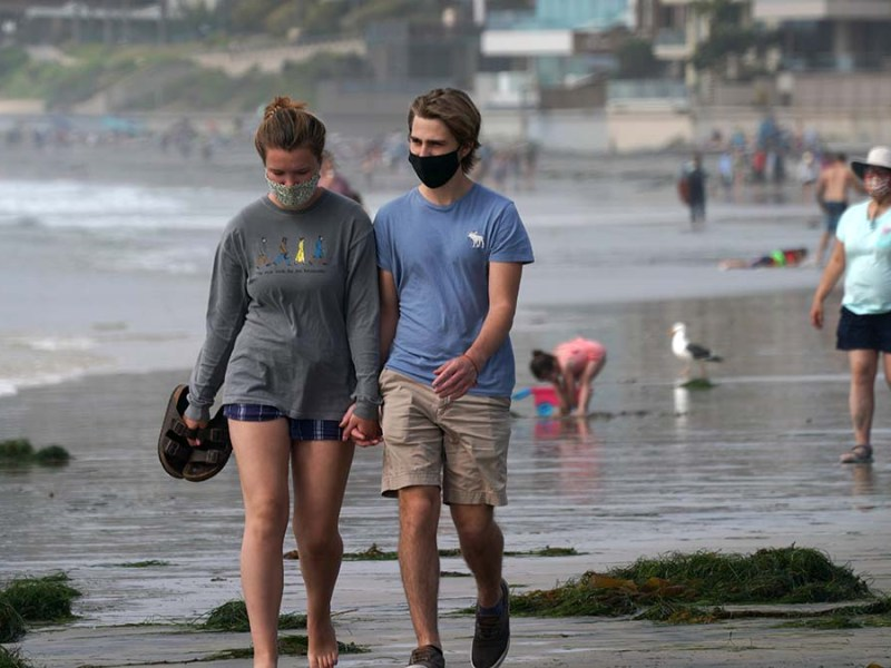 Some beachgoers continue to wear masks. Photo by Chris Stone