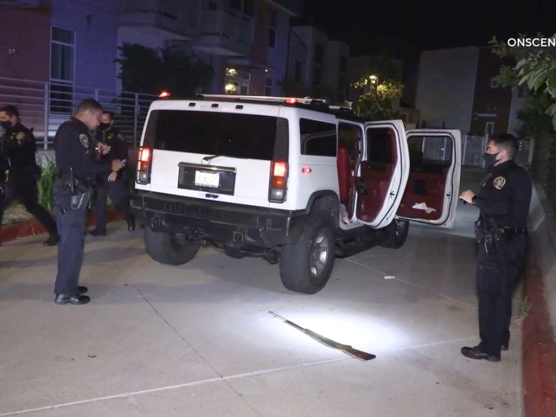 Suspect's Hummer and rifle