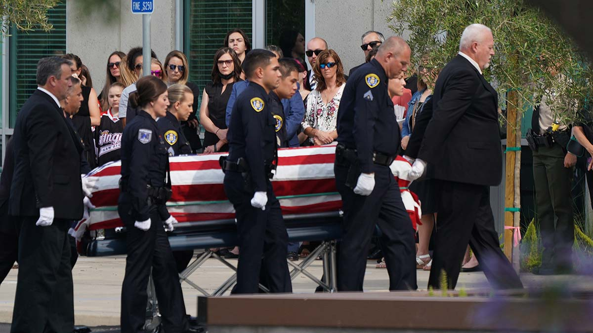 Pallbearers bring the casket of Ryan Park and Jamie Huntley-Park into the chapel. Photo by Chris Stone