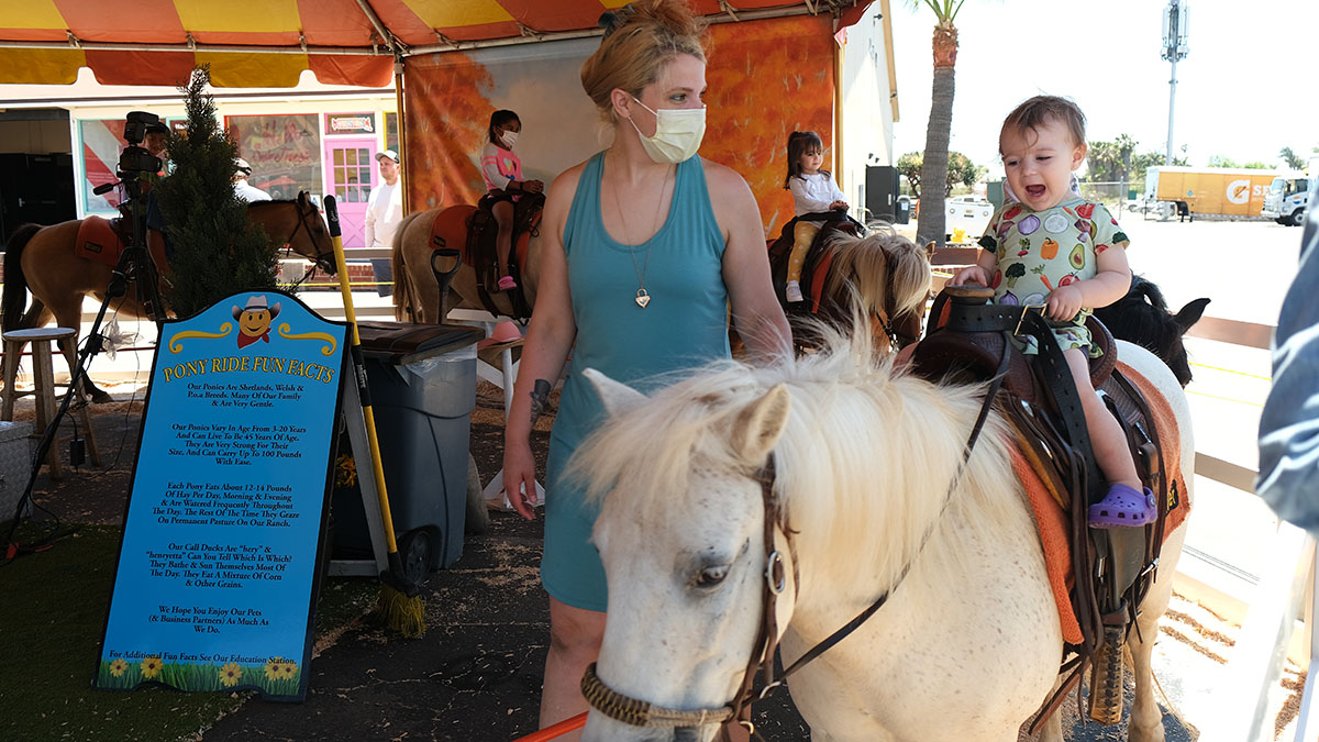 Theresa Snyder and her 1 1/2-year-old daughter Marlene enjoy Happy Day Pony Rides. Photo by Chris Stone