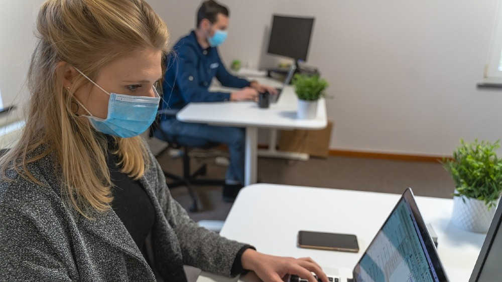 Masked employees in an office