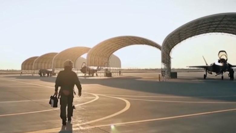 Pilots walks to F-35 jet