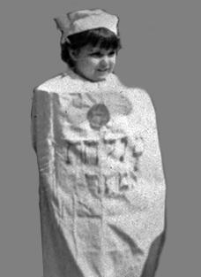 Pat Launer as Megillah scroll