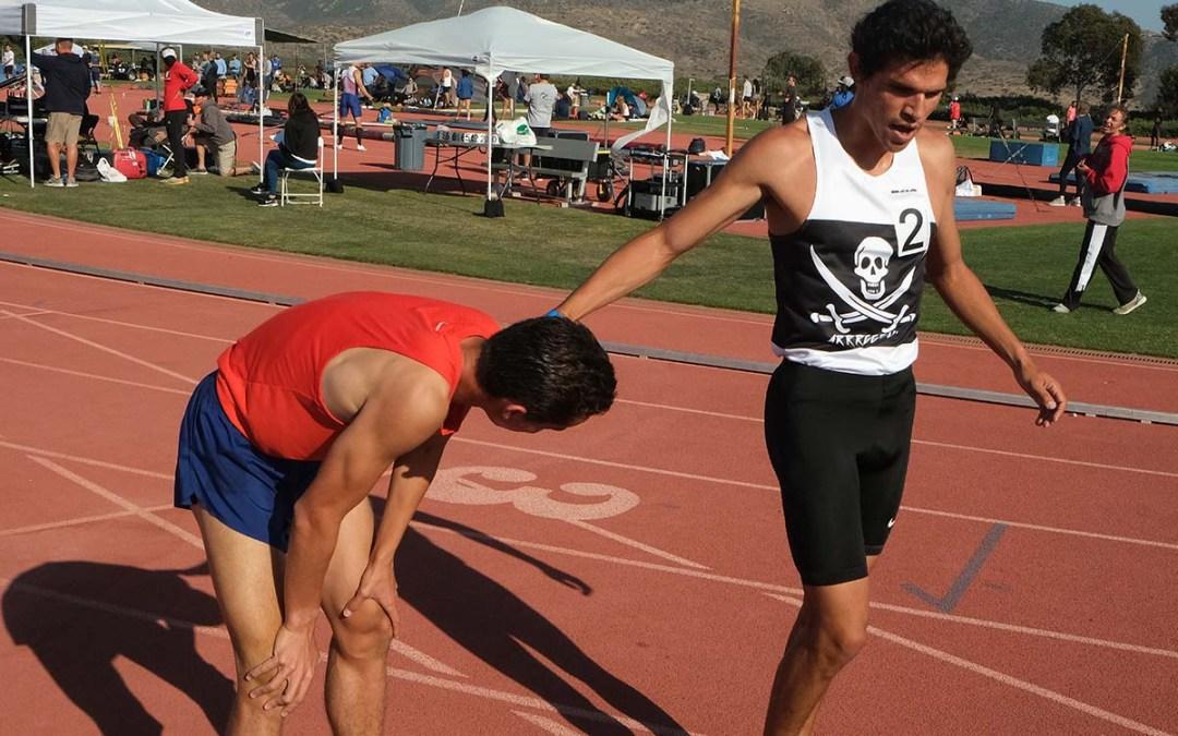 Bernardo Montoya congratulates Joel Gomez after 1500-meter run.