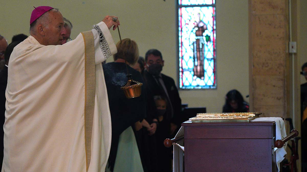 San Diego Bishop Robert McElroy blesses with incense the remains of Fr. Joe Carroll.